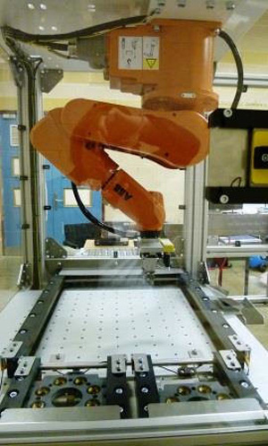 Hanging Robot Reduces Footprint In Contact Lens Production