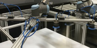 Universal robot eliminates heavy lifting for printer